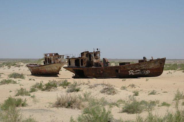 Abandoned ships stranded in the desert. Source