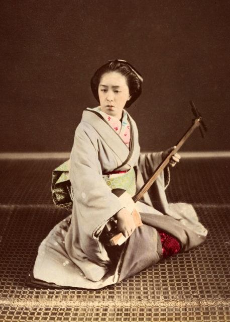 Tokyo geisha with shamisen, circa 1870s