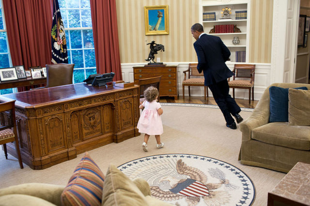 obama oval office desk. President Barack Obama Runs Around The Resolute Desk In Oval Office. Office D