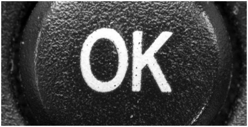 An OK button on a remote control. Photo by Maximilian Schönherr CC BY-SA 3.0