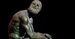 Resting boxer statue