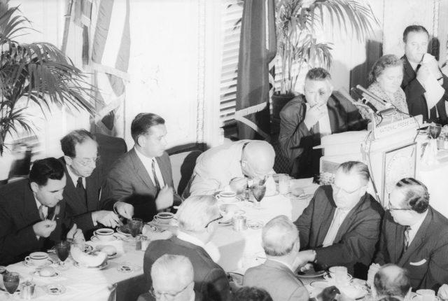 Nikita Khrushchev eating a melon at the National Press Club lunch.