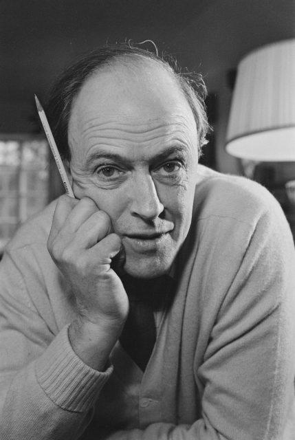 Roald Dahl holding a pencil