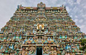 Colourful figures of Hindu deities adorn the gopura tower of the Madurai Meenakshi Amman Temple (Arulmigu Meenakshi Sundareshwarar Temple) located in Madurai, Tamil Nadu, India.