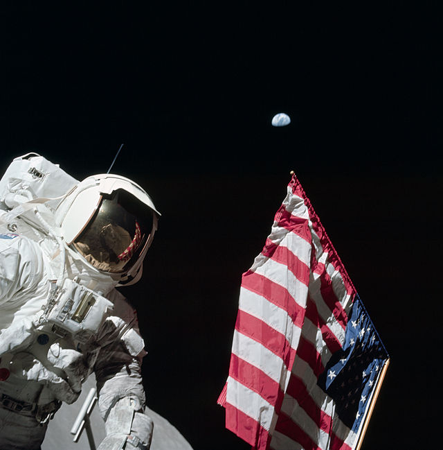 Harrison Schmitt holding the US Flag on the moon