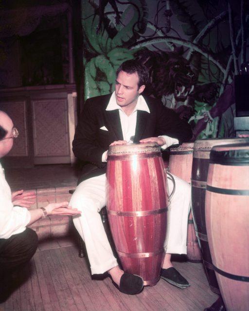 Marlon Brando playing the conga run, 1965.