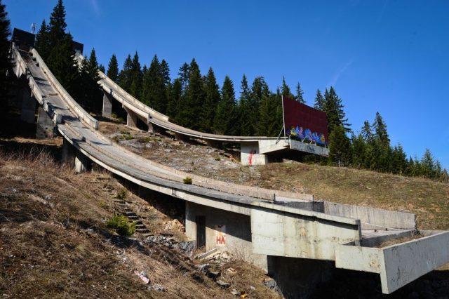 Ski ramp overrun with vegetation and plant life