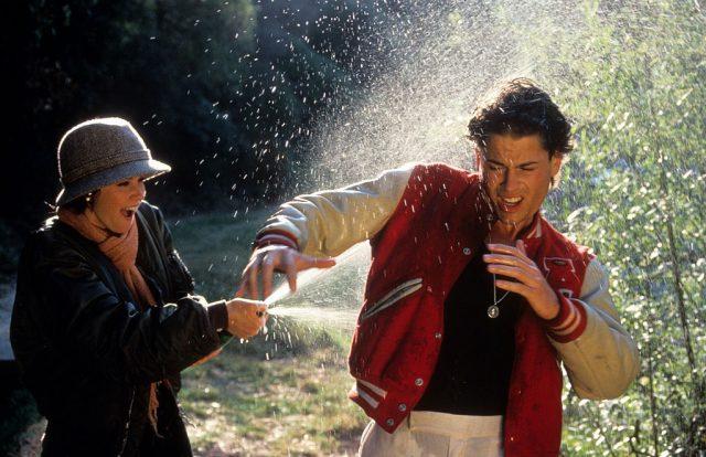Ally Sheedy spraying Rob Lowe with a hose