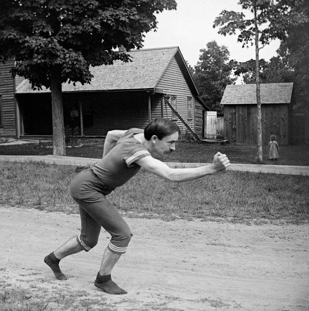 Victorian athlete striking a running pose