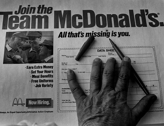 Hand atop a McDonald's job application