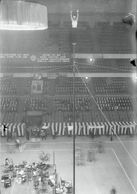 At Madison Square Garden, New York City, Alvin (Shipwreck) Kelly sits aloft on a pole to set another marathon record. (Photo Credit: Bettmann / Contributor)