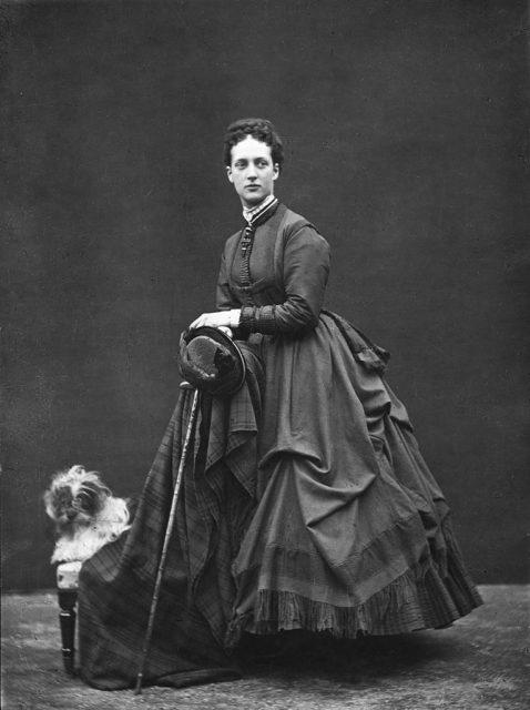 Alexandra, Princess of Wales, standing beside a dog