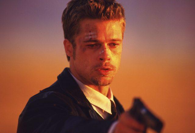 David Mills holding a gun
