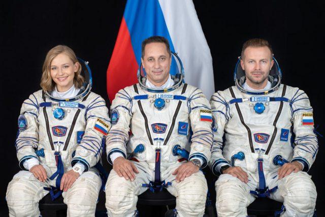 Yulia Peresild, Klim Shipenko and Anton Shkaplerov sitting in spacesuits