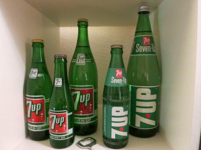 Five empty 7UP bottles